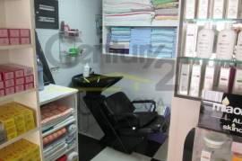 Ambjent komercial tek spitalet